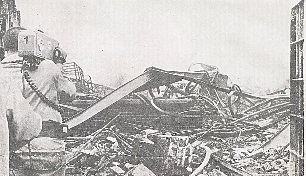 Camera crews capture images of prison wreckage