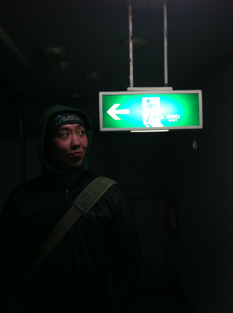 Chris in Japan admiring how low the hallway signs are.