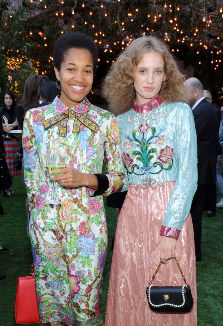 Tamu McPherson  of  All The Pretty Birds    Wearing our  Grand Gold & Onyx Statement  Earring and  The  Elizabeth Bag  with Petra Collins at a Gucci event in NYC.