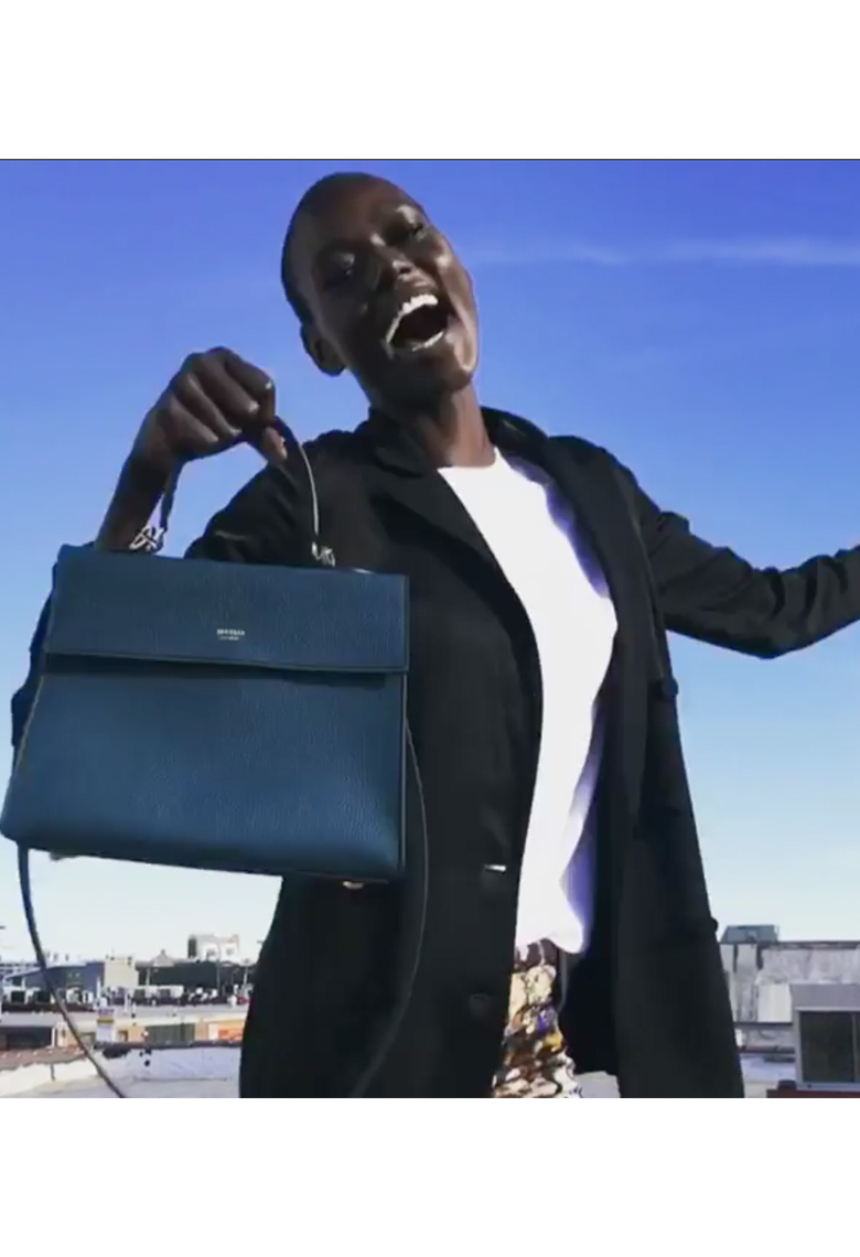 Ajak Deng, Model Wearing our Deep Emerald Elizabeth Bag.
