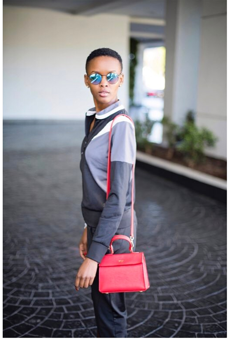 Flaviana Matata , Model   Wearing our  Mini Elizabeth Bag  in Rouge.