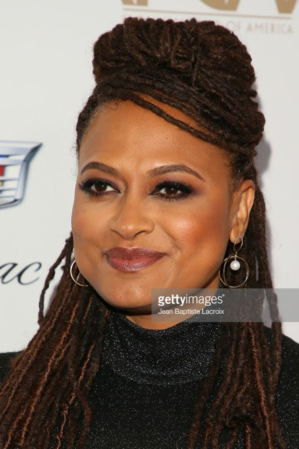 Ava DuVernay, Film Director, Producer, Screenwriter Wears our 14K Gold Half Moon Diamond & Pearl Axis Earrings.