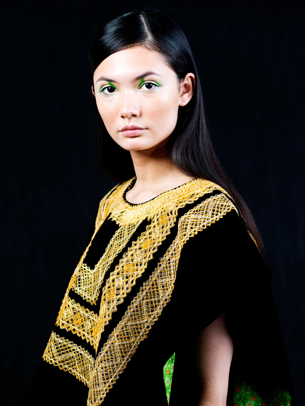 A fashion portrait of a woman wearing an authentic, Oaxacan garment.