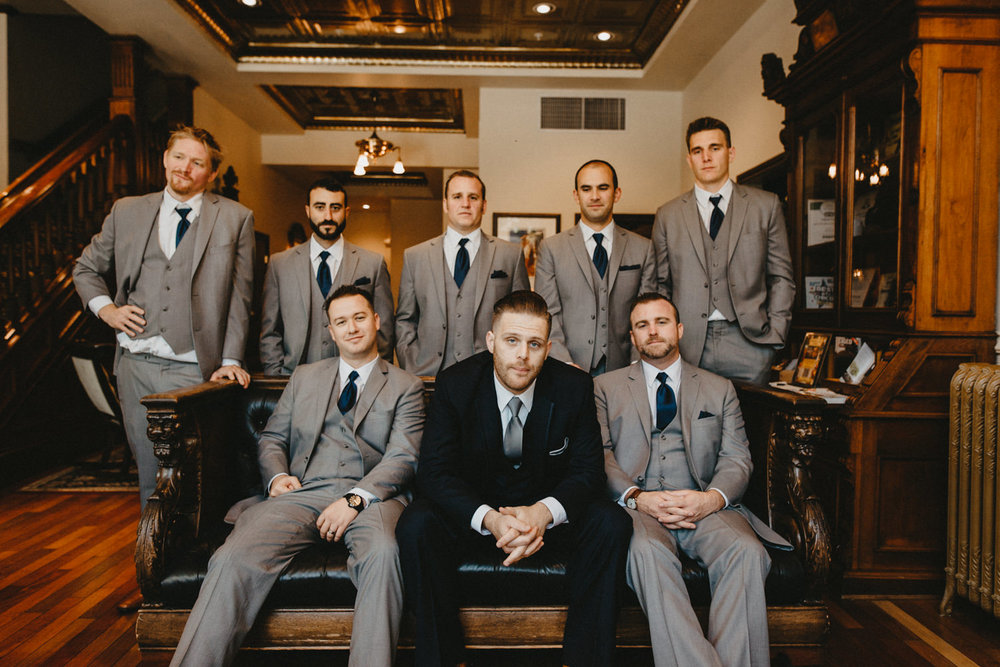 groomsmen and groom sit in the lobby of hotel diamond in downtow