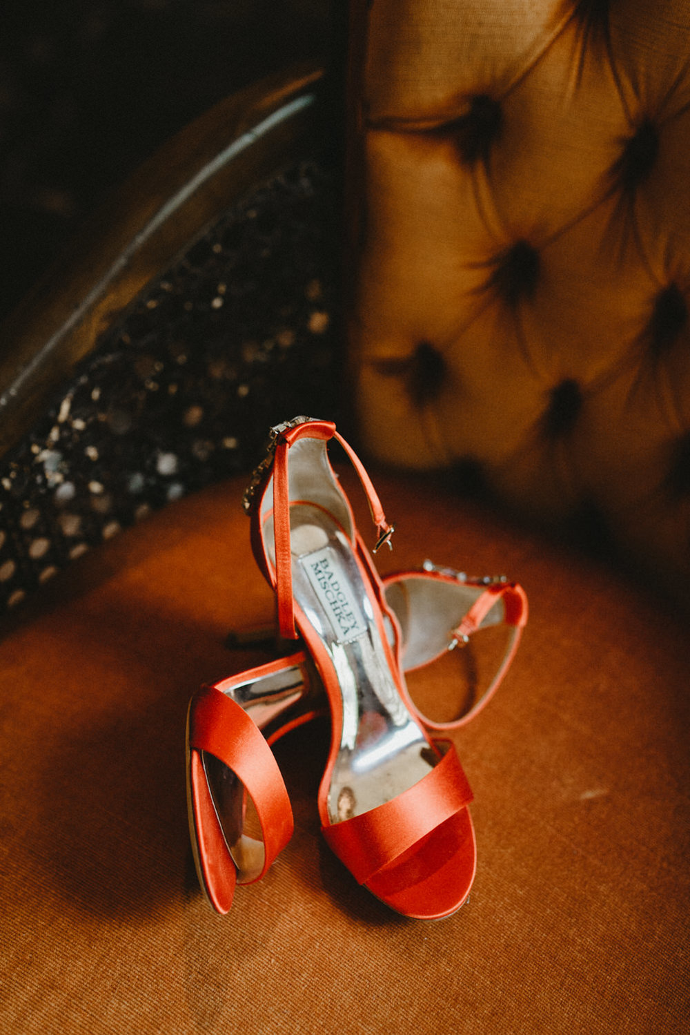 red pair of badgley mischka high heel shoes