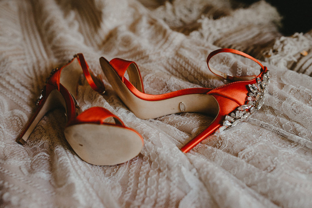 red heels on a wedding dress