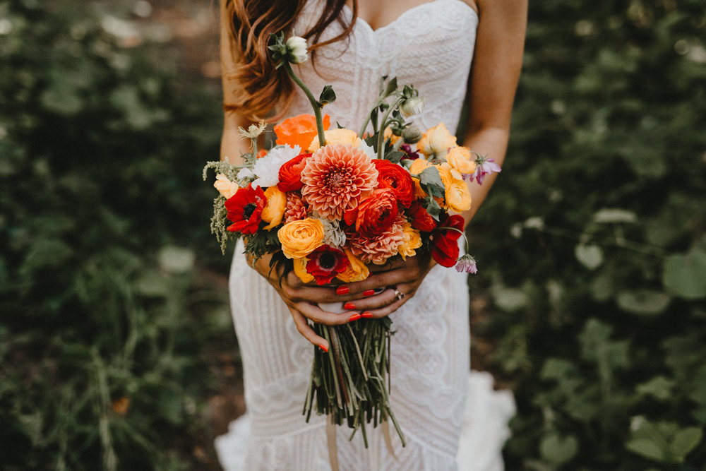bride holds her diy bouquet