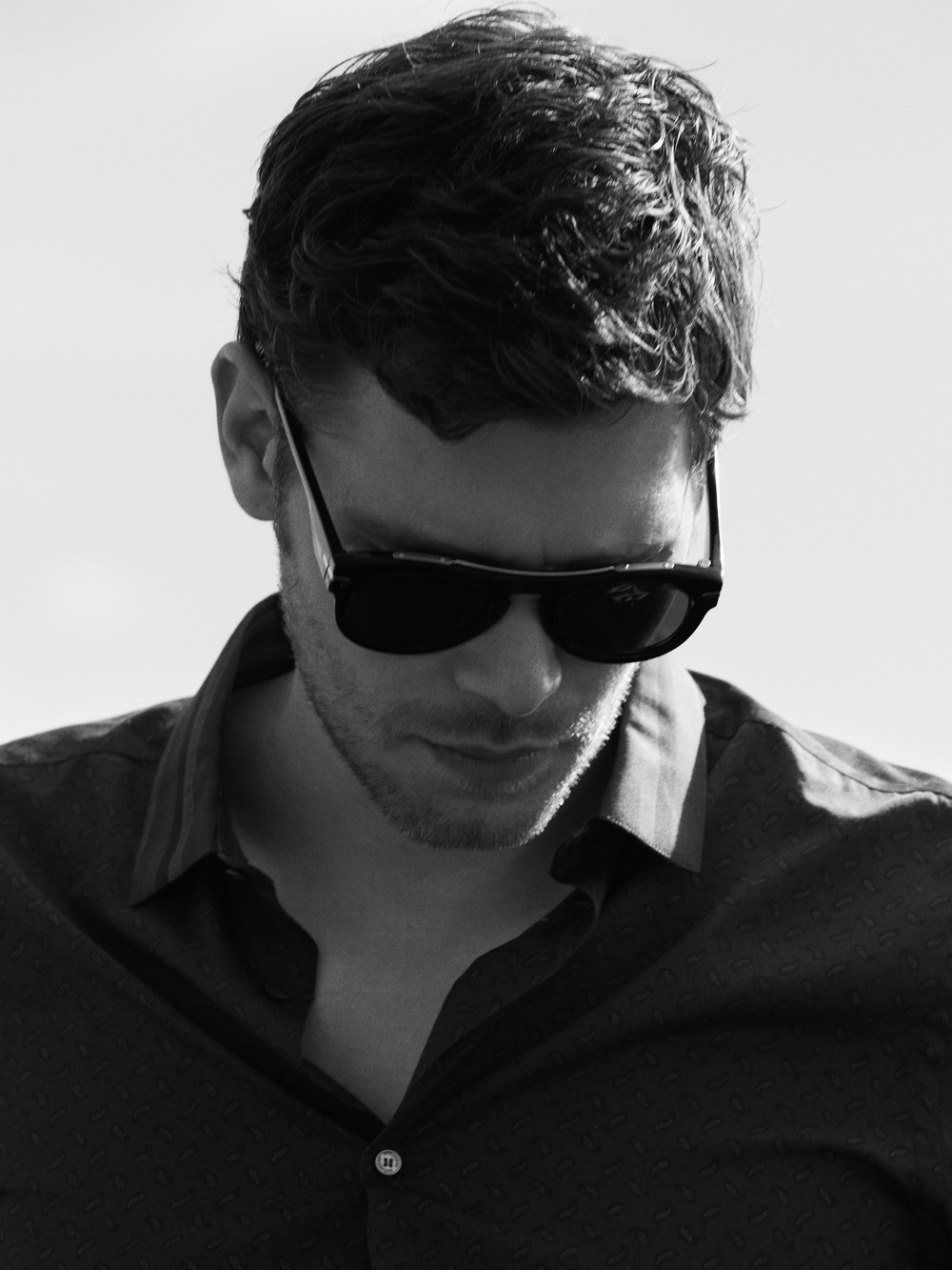 Top by    BURBERRY LONDON    ,Sunglasses by  G-STAR RAW  .