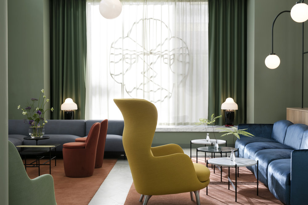Lobby seating area: Soft Beat and Claudine sofas by Ar ex, GamFratesi TS Tables by Gubi, Palette Table by & tradition, Chinoz Table Lamps by Parachilna, Ro armchair by Fritz Hansen Face Structure and Hanging Lamps special designs by Jaime Hayon for Hotel Barceló Torre de Madrid