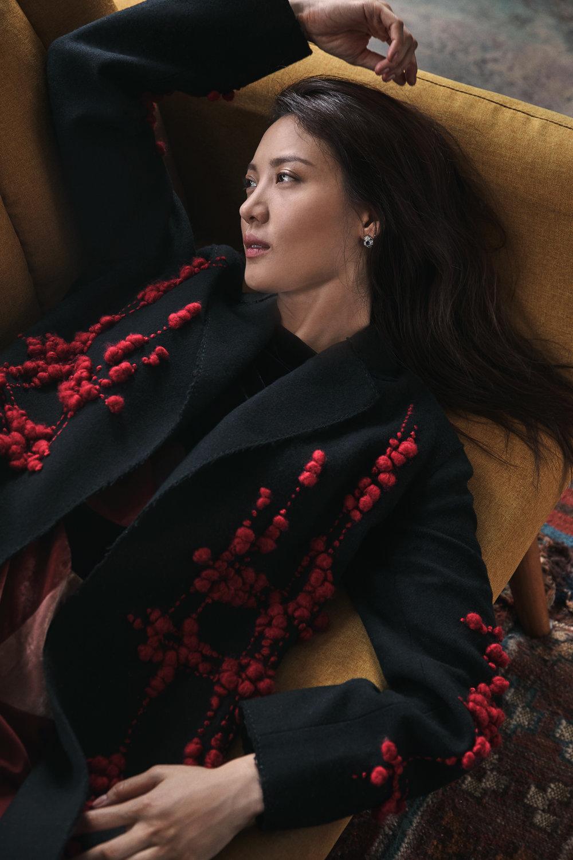 Coat and dress by   BOTTEGA VENETA  ; Earrings by   BVLGARI