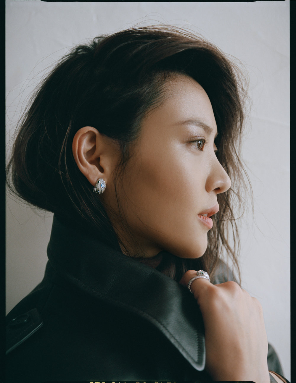 Trench and turtleneck by   SALVATORE FERRAGAMO  ; Earrings and Ring by   BVLGARI