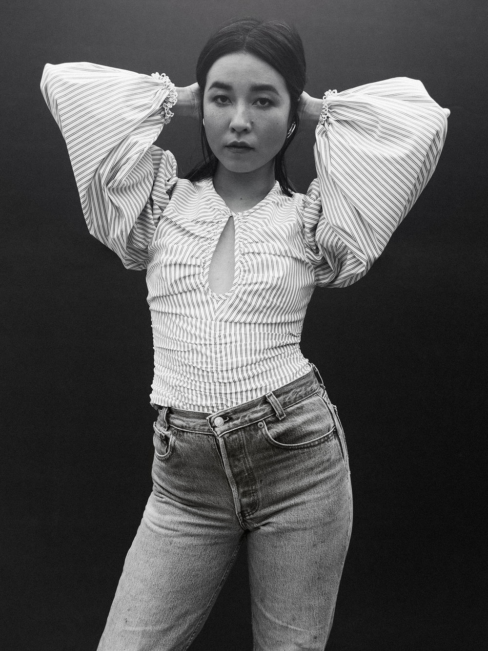 Top by   C/MEO COLLECTIVE  ; Jeans by   LEVI'S  ; Earrings by   COS