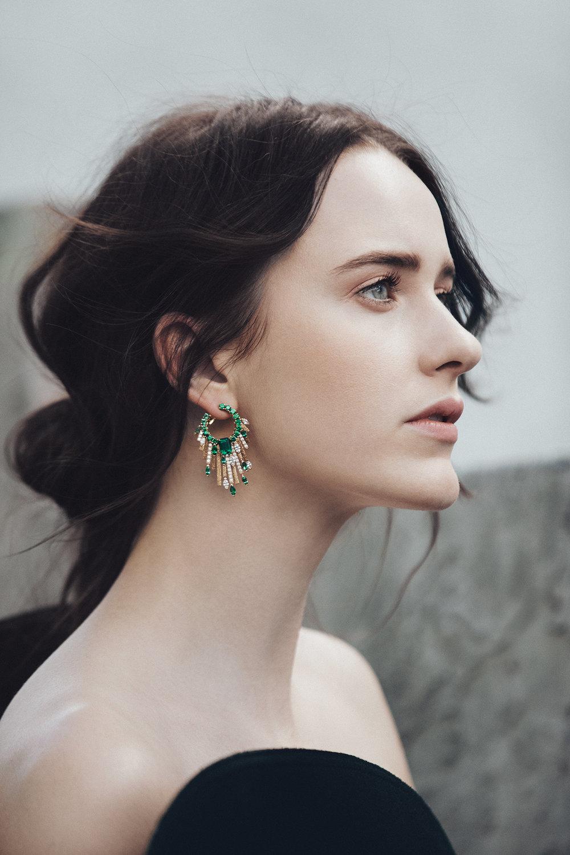 Dress by   SAINT LAURENT  ; Earrings by   PIAGET