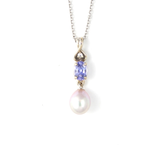 Tanzanite and pink pearl pendant in white gold capones jewelry tanzanite and pink pearl pendant in white gold aloadofball
