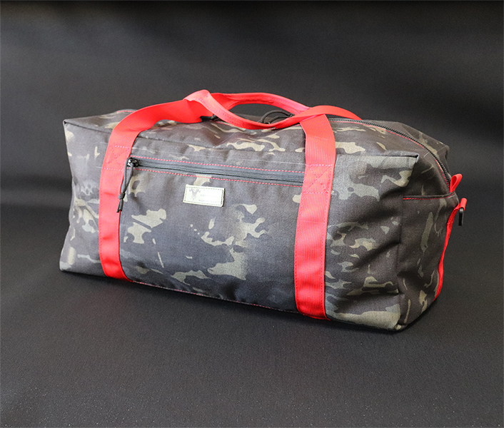 Duffel Bag Multicam Black Red Handles Angle.jpg
