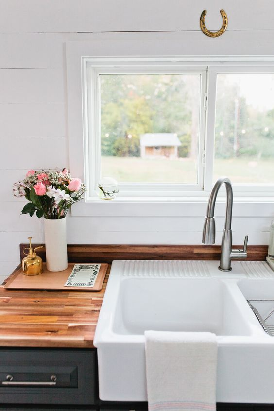 Everything about this is beautiful! But we especially love the darker cabinets against the white shiplap. And who doesn't love a farmhouse sink? Plus, these countertops are gorgeous!