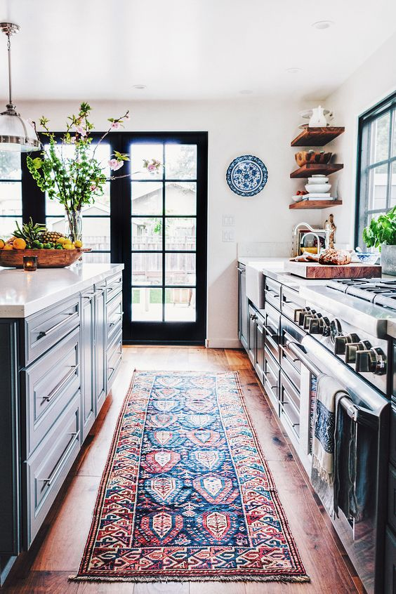 "This rug! A beautiful rug in the kitchen takes you from sterile to warm, instantly. Some people ask, ""what if you spill something?"" That's the beauty of buying vintage rugs, the stains and wear they go through are part of their journey.  And it's really not a bad idea to get them cleaned from time to time. Our favorite place to shop rugs is at Kennedy Rose Interiors, Jessica has something for everyone, and her rugs are beautiful!"