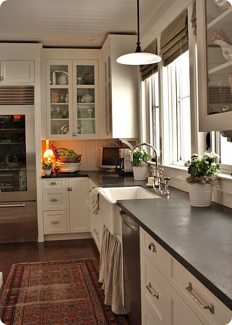 Encouragement! When we bought our house we didn't have too many options with countertops. We could have chosen a modern quartz or marble, but the upgrade charge was outrageous. One of the four granite choices was a deep dark green/emerald granite. Our kitchen doesn't get much natural light, but of all the choices it was definitely our favorite. Kitchens like the above reaffirmed that dark countertops don't have to make your space small and dark, but can actually create a cozy feel.