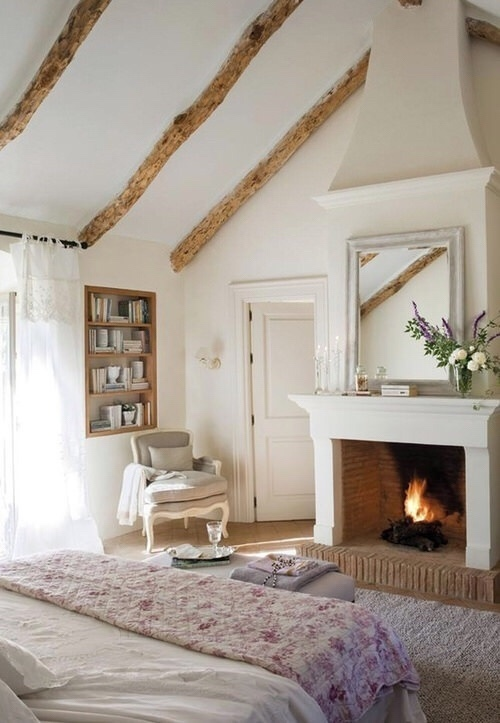 Isn't this fireplace and mantle just lovely? A large mirror is always a great idea, and it makes the overall space appear larger allowing more light to bounce around. Let us know if you're looking for a mirror, we know where you can find one :).