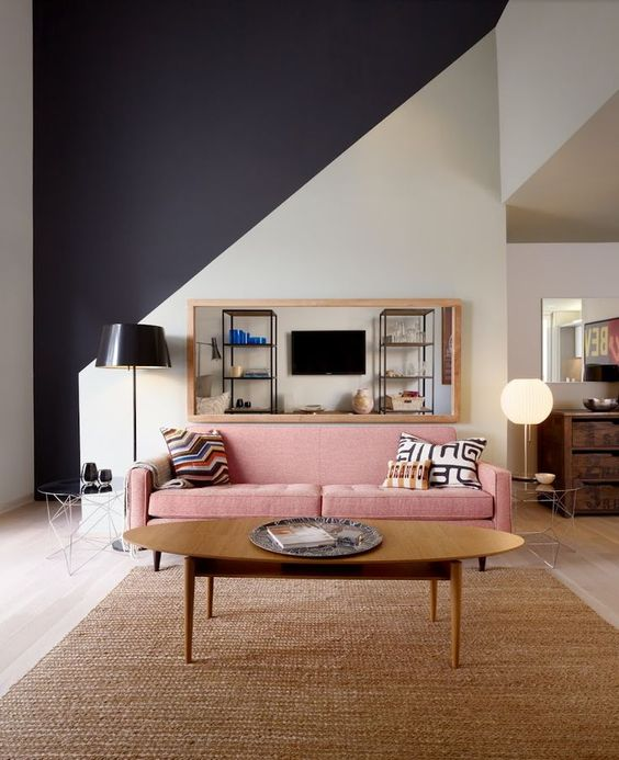 This large horizontal mirror above the couch makes the space feel huge.