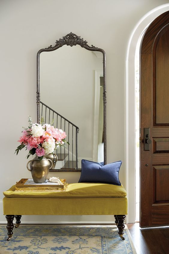 This vintage mirror is gorgeous and frames in the bench, creating it's own beautiful space.