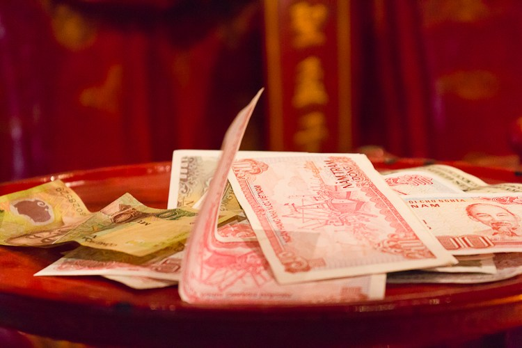Money left at a shrine in the Temple of Literature in Vietnam.