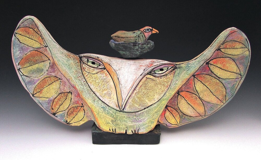 """owl person and beauty bird dreaming into being                                          hand built from earthenware. underglaze. 16"""" wide"""