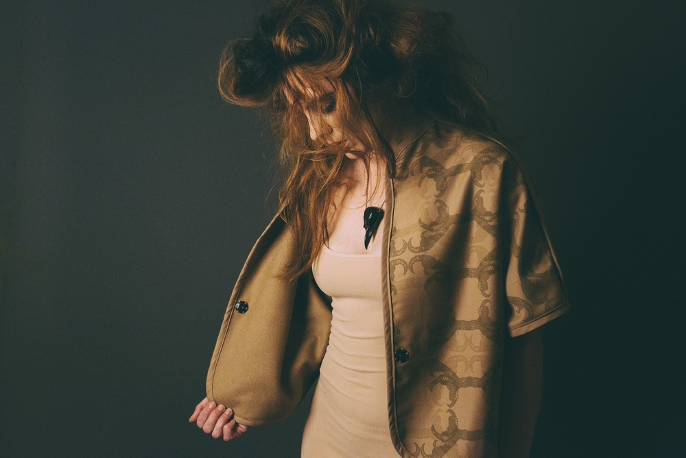 Girl holds open jacket from The Guardian collection