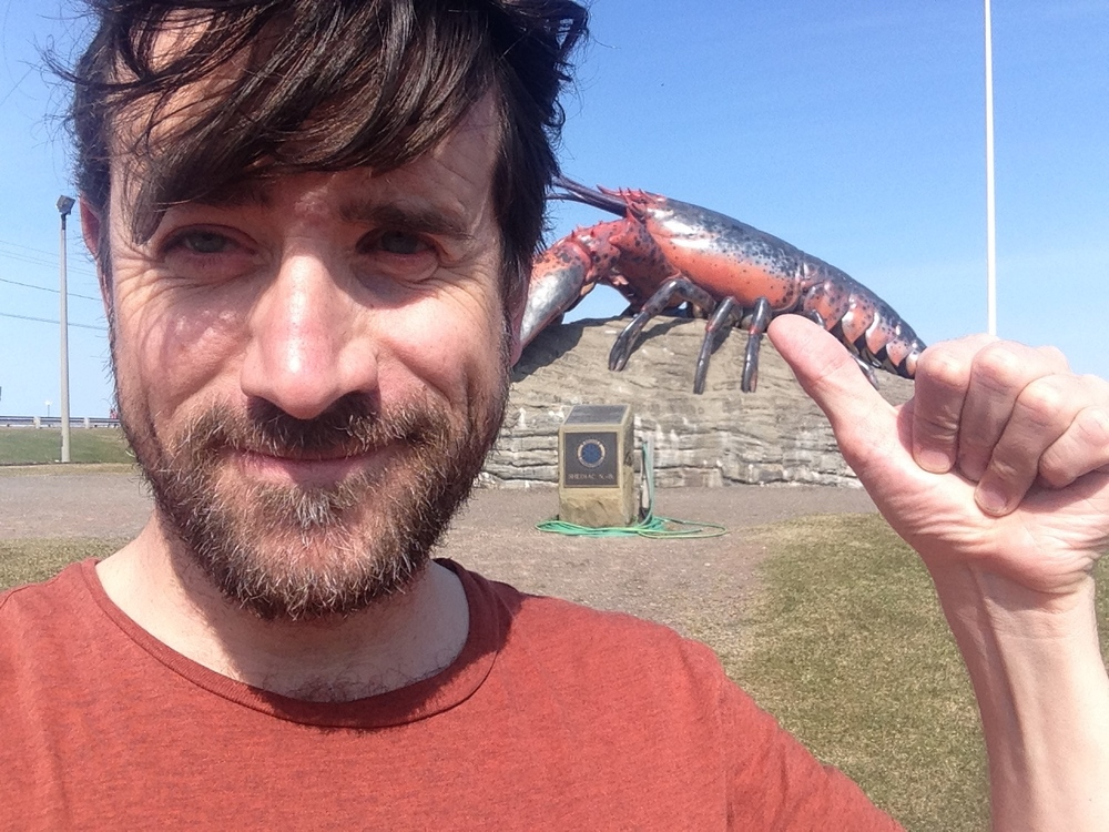Me and the Lobster.  The perspective in this photo makes him look quite small... and like I have quite the unwelcome thumb.