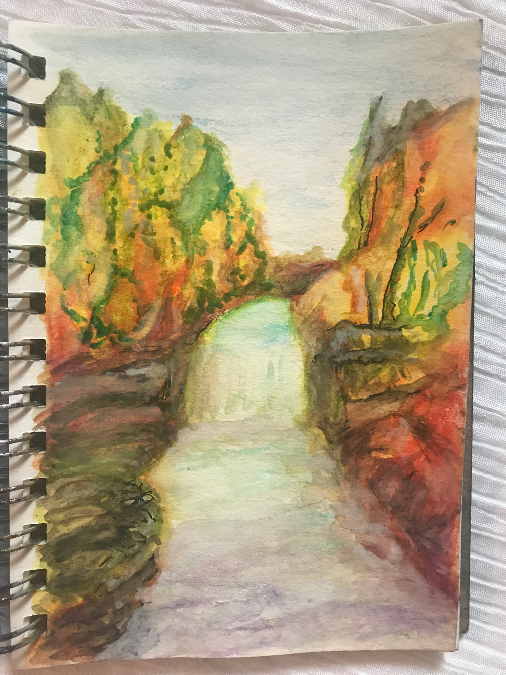 Image description: Watercolour sketch of a waterfall in Northern Ontario.  Warm, soft colours reflecting the Fall Season