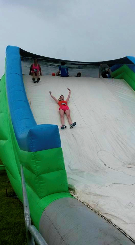 Sliding down the final obstacle.