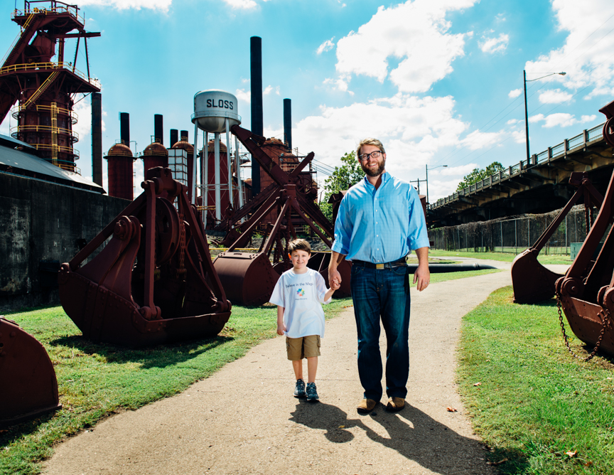 Will Haver, president of Wilco Holdings and owner of Taco Mama, walks with Connor, 6, at Sloss Furnace in Downtown Birmingham. Men of Magic Moments calendar 2016. (Photo: Andrea Mabry)
