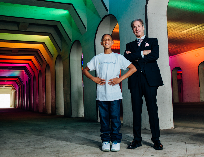 Jack L. Schaeffer, president and CEO of Schaeffer Eye Center, stands with TaRell, 11, in the light tunnel on 18th Street in Downtown Birmingham. Men of Magic Moments calendar 2016. (Photo: Andrea Mabry)