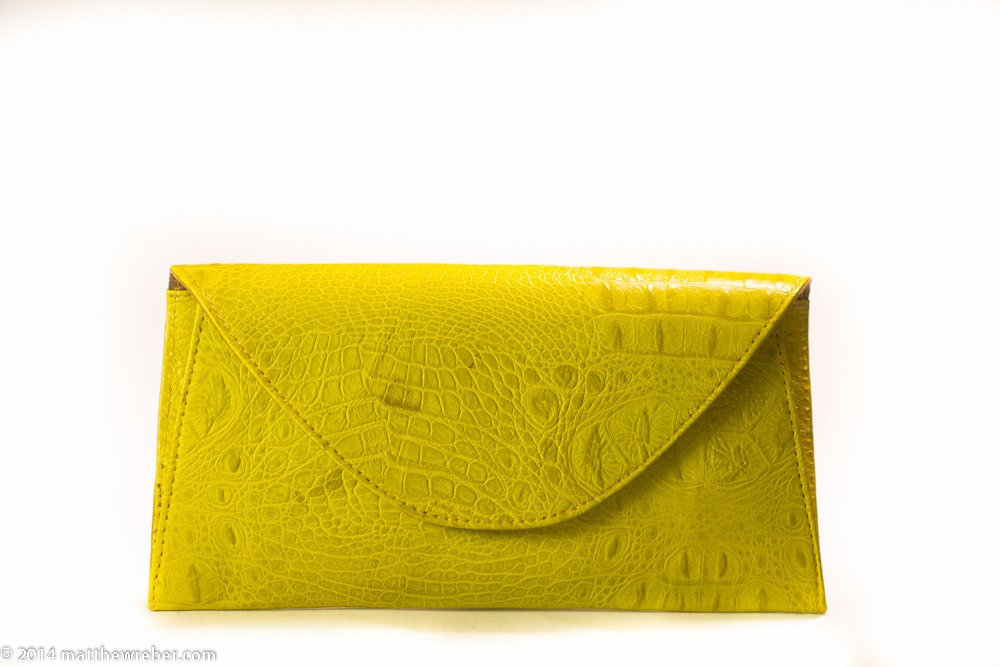 Handmade citrine yellow envelope clutch made from real leather in first collection from Lagos, Nigeria.  A portion of proceeds to to support artisans and designers at Lekki Market.  Shop at etsy.com/shop/dualcitizenshop