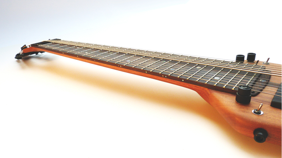 The neck is not only sexy, but also stiff enough for a nice low action.   Dual adjustable truss rods  and optional  carbon fiber stringers  keep it so.