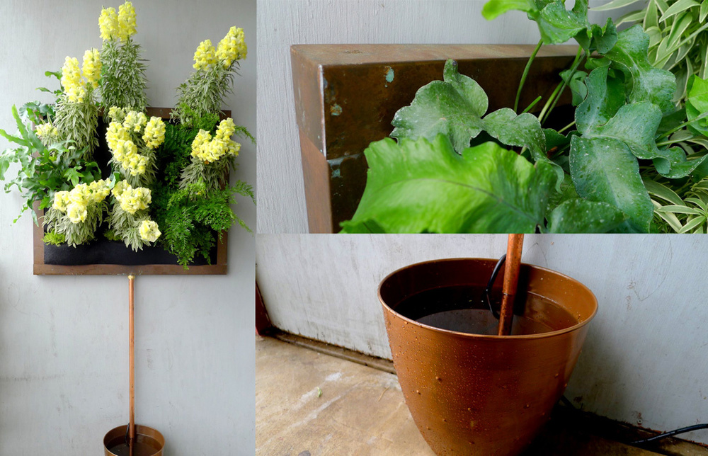 Copper Framed Vertical Garden with Snapdragons and small water container.