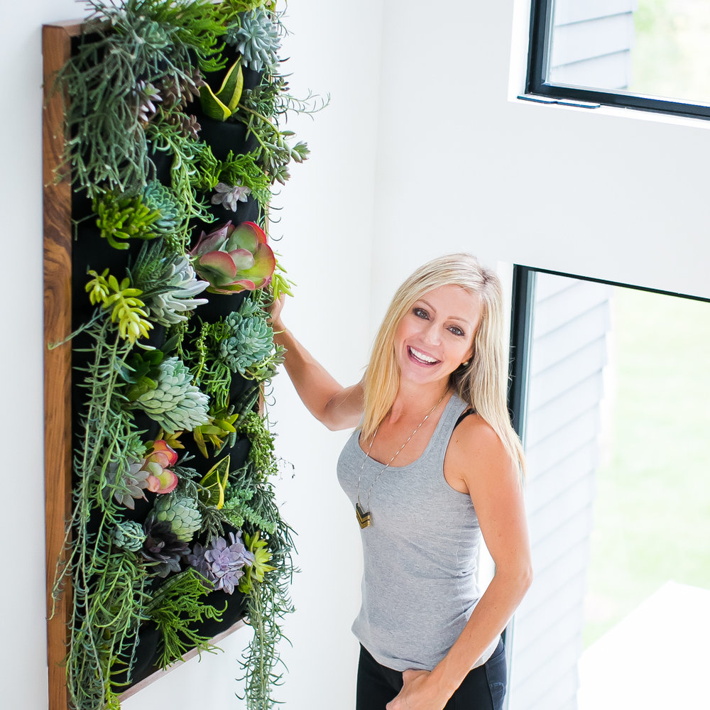 Professional Photographer Jamie Sangar with her Florafelt vertical garden designed with succulents.