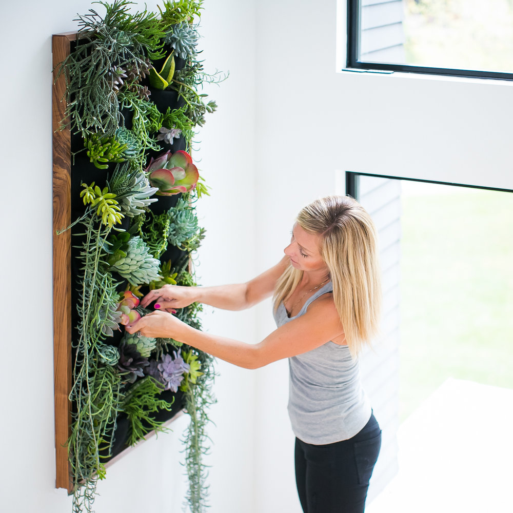 Jamie Sangar makes final touches on her Florafelt succulent vertical garden.