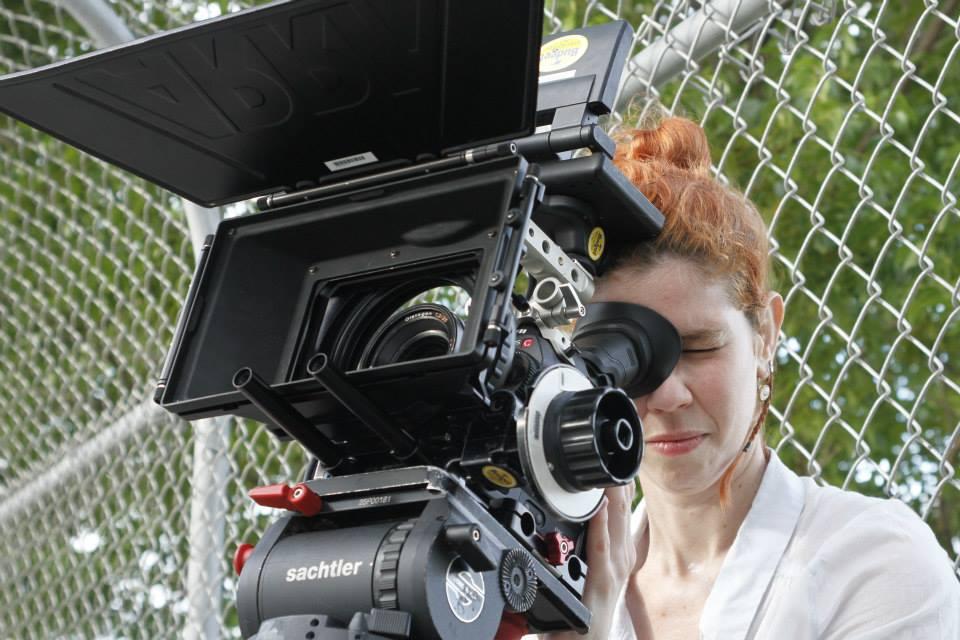 always behind the camera -