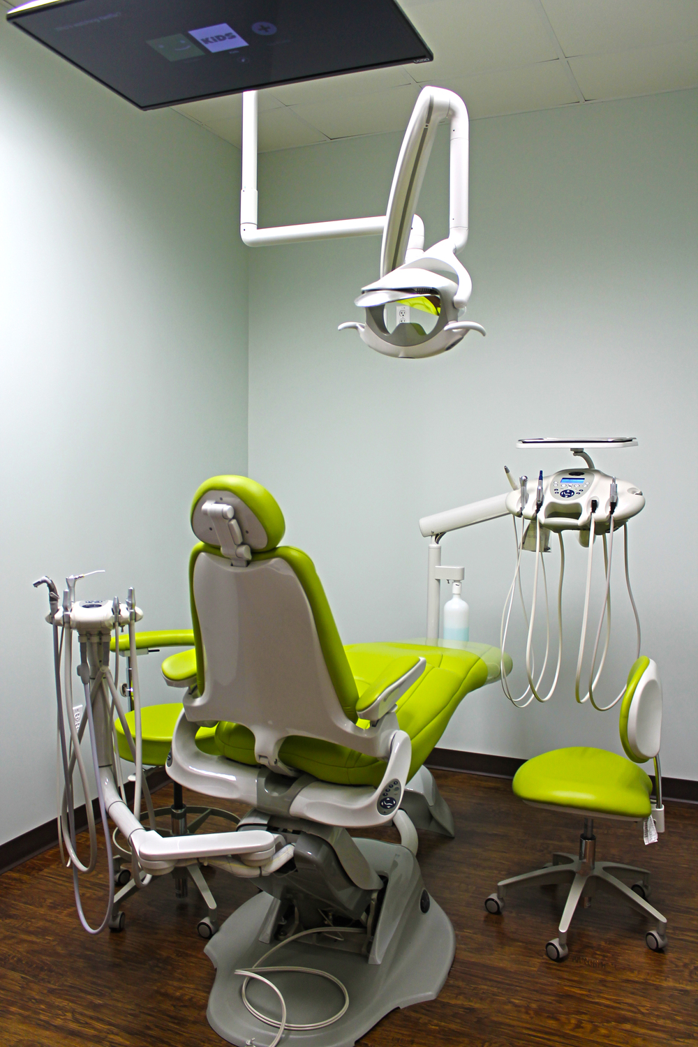 Operatory with ceiling mounted TV's with Netflix and chair massage