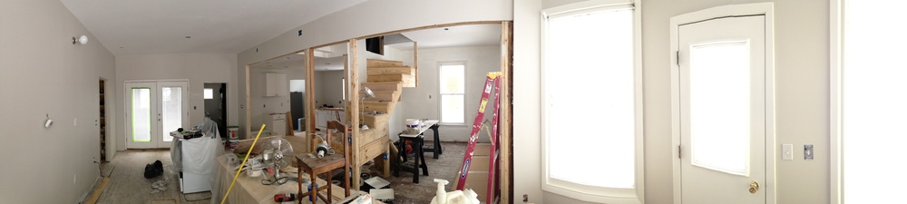 My Uncle came and helped us with some electrical work and I learned how to install the light fixtures - so far just the sconces you see in the upper left corner of the photo