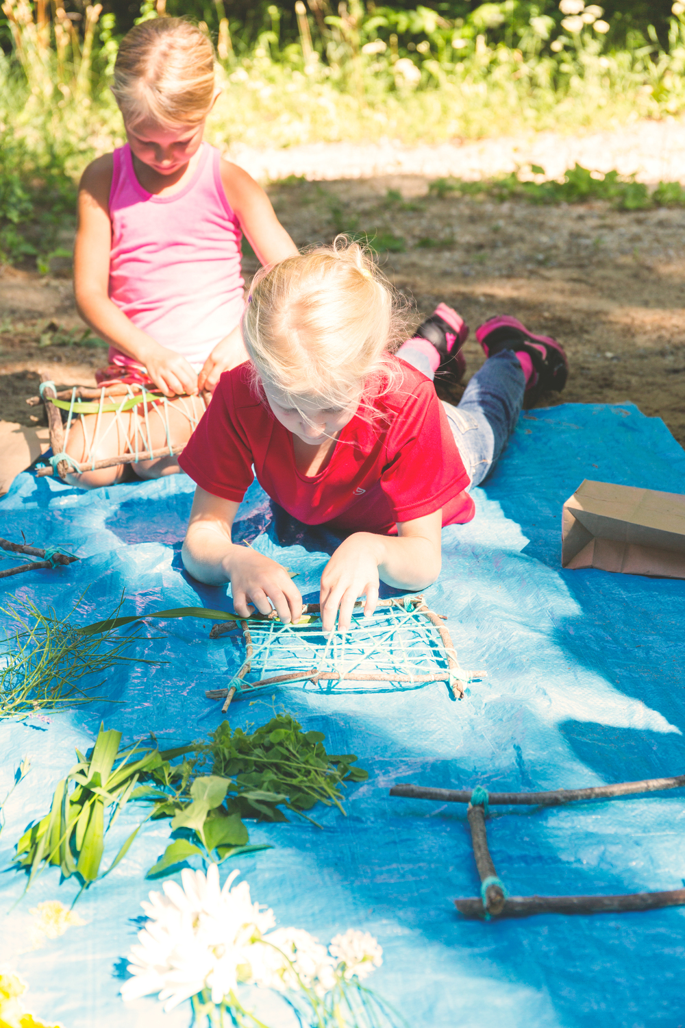 7/13/16 Nature Weaving class through Little Traverse Conservancy at the McCune Preserve. One of my favorite classes + favorite preserves to explore. This weaving project is fun for kids and adults, especially if you enjoy collecting (hording?) found objects, like I do. The look of the weavings change as the leaves and petals dry out. Try hanging them in a window or against a wall. Materials: 4 sticks (tied together at corners), yarn (looped around sticks and crisscrossed), found objects for weaving into the yarn (feathers, leaves, flowers, trash).