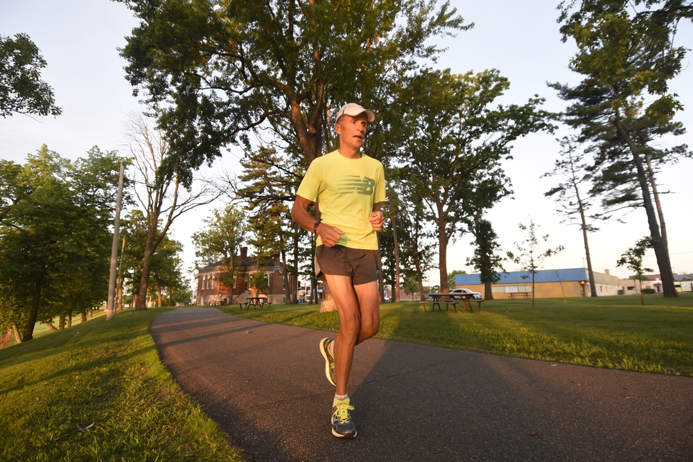 Dick Beardsley runs along the bike path as the sun rises in Bemidji. This photo ran on the cover of the special 40th Grandma's Marathon edition of the Duluth News Tribune.
