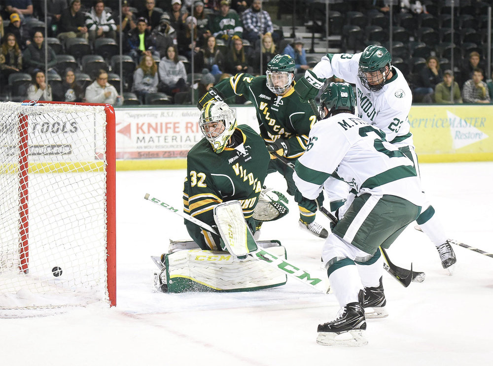 Bemidji State's Myles Fitzgerald scores on Northern Michigan goalie Mathias Israelsson in December 2017.