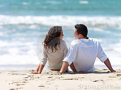couple-sitting-together-beach-5168297.jpg
