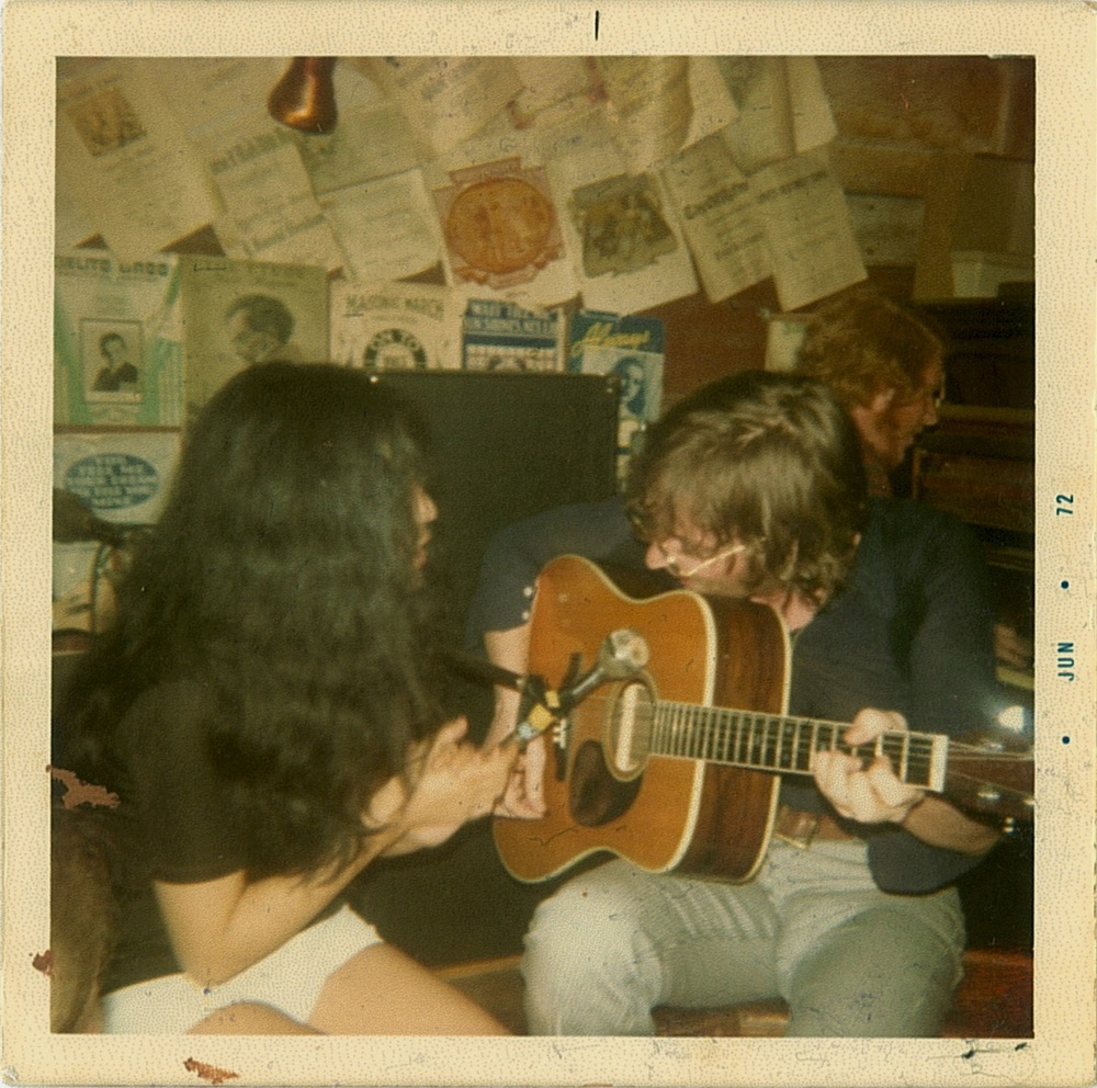That's Chaz Pett in 1972 playing the piano and singing like crazy (he had no mic but still blended well with John).