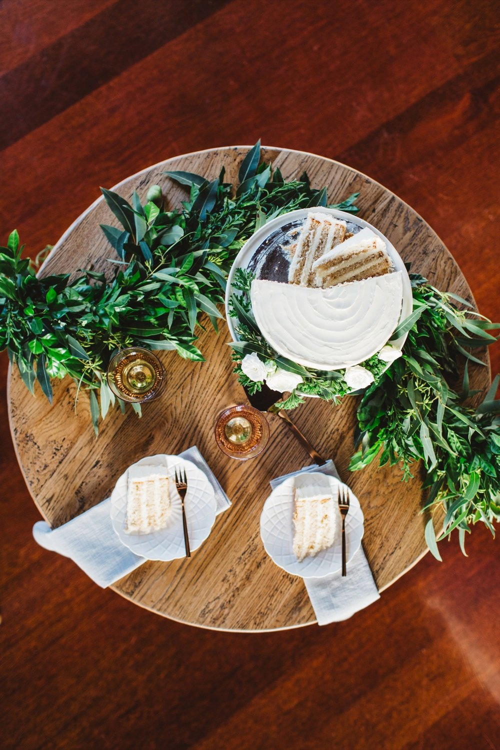 Tables can also be brought to life by the simple addition of a Garland of Greenery.  Garland created by Bella Bloom Floral Designs.  Image The White Tree from our TBM Real Couple Search.
