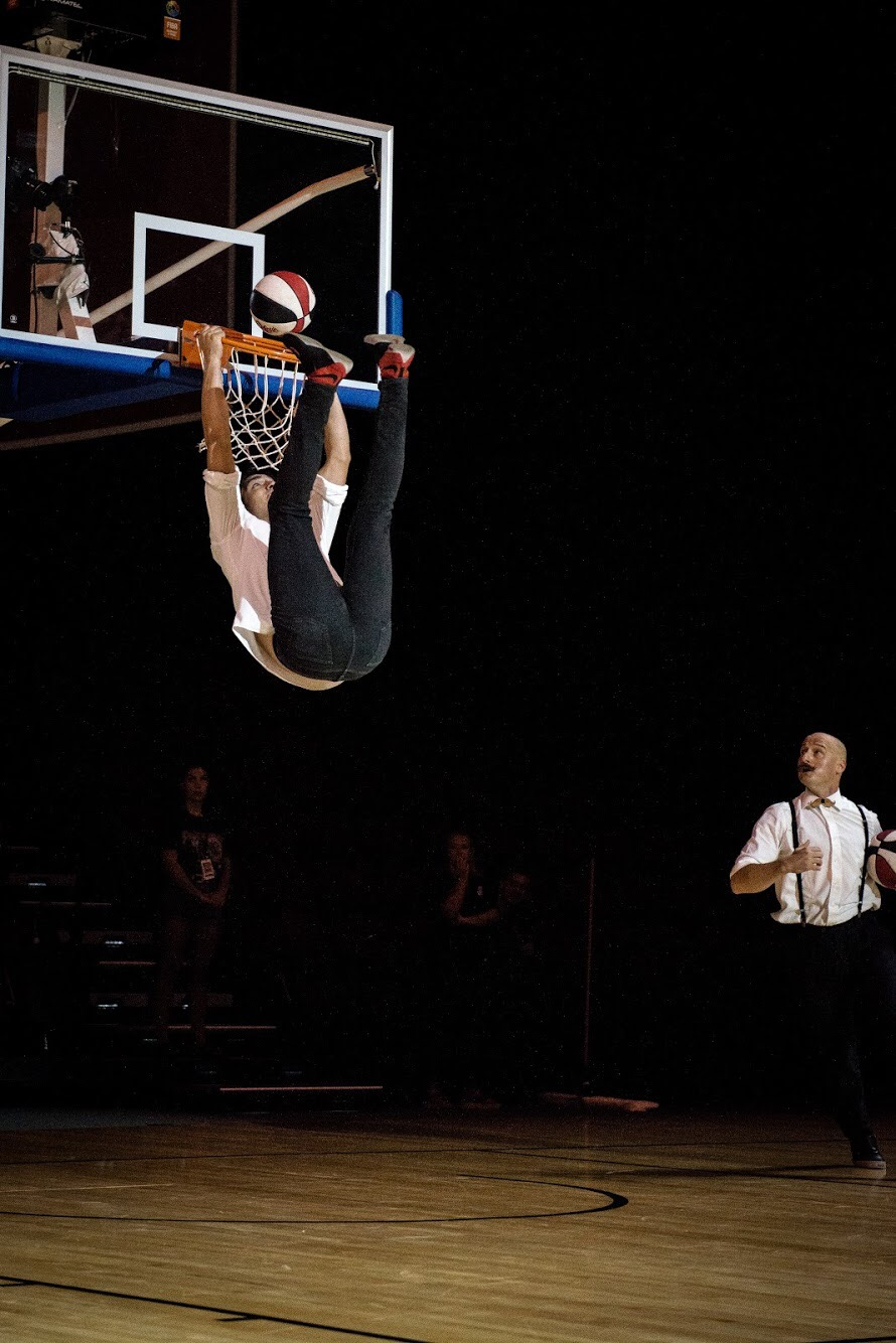 Gian Marco Oddo Preforimg a dunk with his feet.