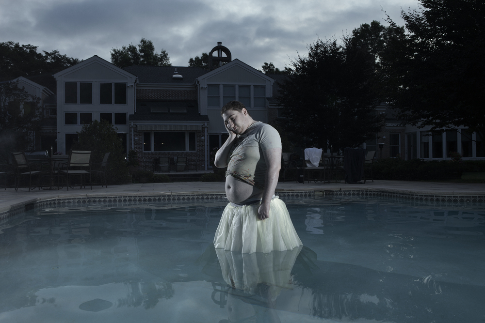 hunter  in the pool in a dress. long island, new york