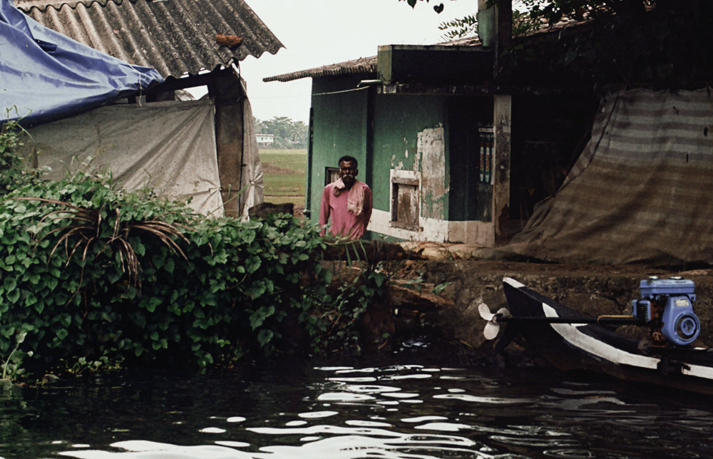 Man at home  in the Backwaters.